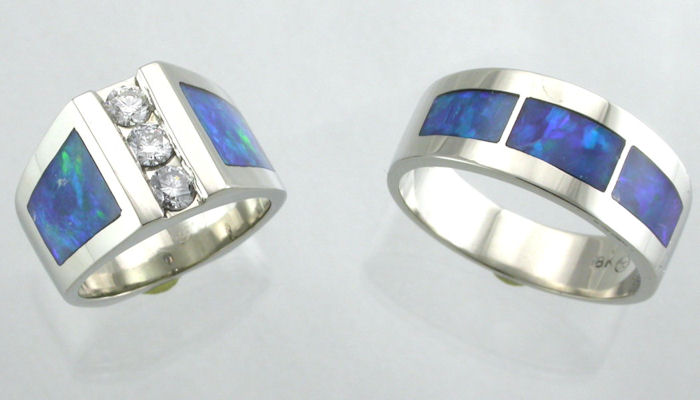 14kt white gold wedding rings with opal inlay the ladies ring has three channel set diamonds - Opal Wedding Ring Sets