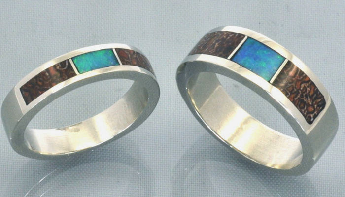 this set of matching wedding bands might appeal to the outdoor enthusiasts with its earthy organic look cast in sterling silver and inlaid with solid - Dinosaur Bone Wedding Ring